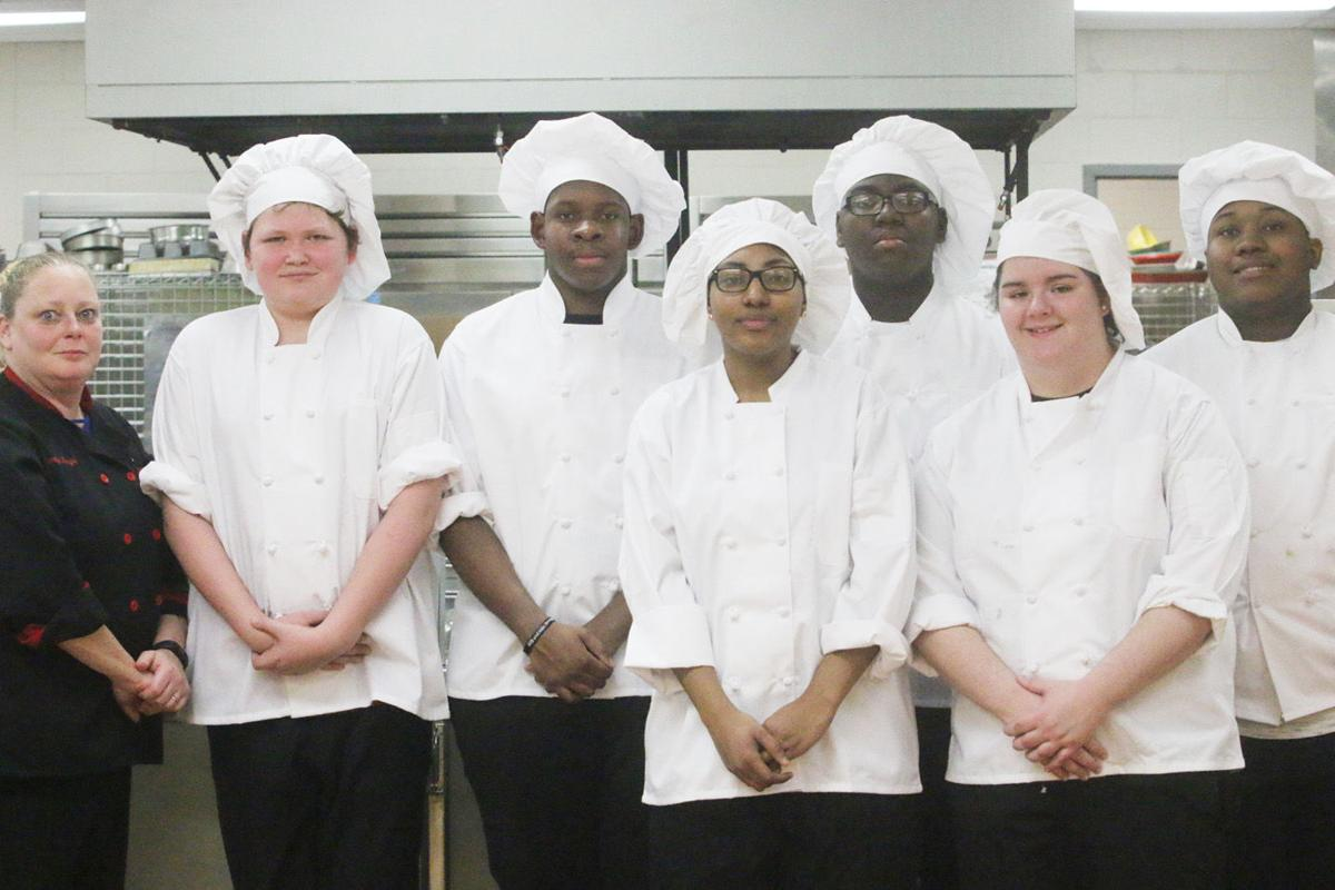 Culinary Chef Jennifer Ferguson, left, with her Culinary Arts students.